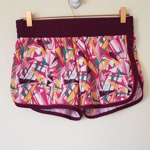 Under armour size medium purple geo pattern shorts
